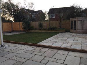 Indian Sandstone Patio with Timber Sleepers and Turf in Nuneaton
