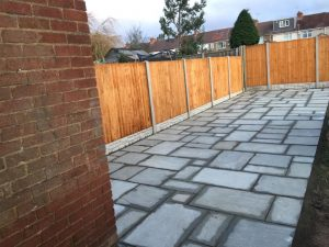 Indian Sandstone Patio with new Fencing in Rugby