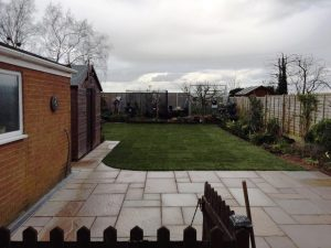 New Indian Sandstone Patio with Turf in Nuneaton